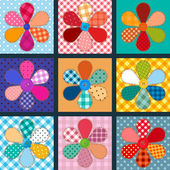 Set of four patchwork flowers — 图库矢量图片
