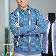 Tailor Standing Arms Crossed By Table — Stock Photo #12219346