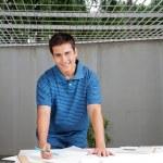 Architect Working On Blueprints — Stock Photo #12378303
