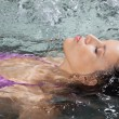 Female Relaxing In Jacuzzi - Stock Photo