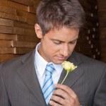 Male Executive Holding Yellow Rose — Stock Photo