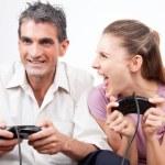 Постер, плакат: Couple Playing Computer Games