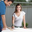 Female Architect Working On Blueprint — Stock Photo