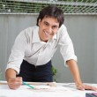 Foto Stock: Male Architect Working On Blueprint