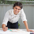 Stok fotoğraf: Male Architect Working On Blueprint