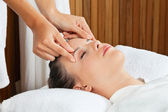 Female Receiving Head Massage At Spa — Stock Photo