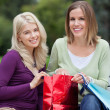 Happy Women With Shopping Bags — Stock Photo