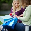 Stock Photo: Women Looking Into Shopping Bags
