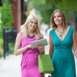 Female Friends Using Digital Tablet — Stock Photo