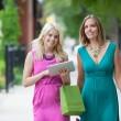 Female Friends Using Digital Tablet — Stock Photo