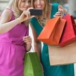 Shopaholic Women Taking Selfportrait — Stock Photo #12658637