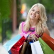 Happy Shopaholic Woman — Stock Photo #12658927
