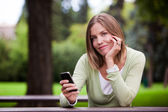Woman holding Cell Phone — Stock Photo
