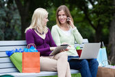 Shopping Women Using Digital Tablet and Cellphone — Stock Photo
