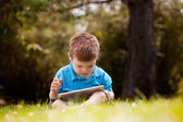 Young Boy with Digital Tablet — Stock Photo