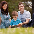 Family Park with Digital Tablet - Stock Photo