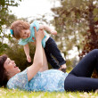 Stock Photo: Mother and Daughter Playing in Park
