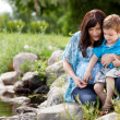 Stock Photo: Mother and Son Playing Near Lake