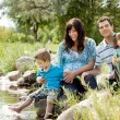 Foto Stock: Family Portrait Near Lake