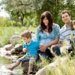 Family Portrait Near Lake — Stock Photo
