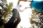 Father Spinning Son in Park — Stock Photo