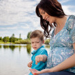 Mother and Son Playing near Pond — Stockfoto