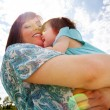 Mother and Daughter Hugging Outdoors — Stok fotoğraf