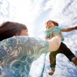 Royalty-Free Stock Photo: Mother Throwing Daughter into Sky