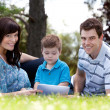 Young Boy With Parents in Park — Stock fotografie