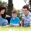 Young Boy With Parents in Park — Stockfoto