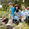 Family Near Lake in Park — Stock Photo #12678006