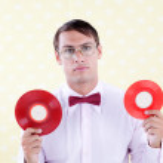 Geek with Vinyl Record — Stock Photo