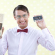 Man Holding Old Audio Cassette — Stock Photo #12679278