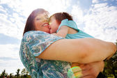 Mother and Daughter Hugging Outdoors — Stock Photo