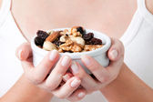 Woman Holding Bowl of Dry Fruits — Stock Photo