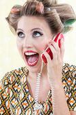 Surprised Woman Using Telephone — Stock Photo