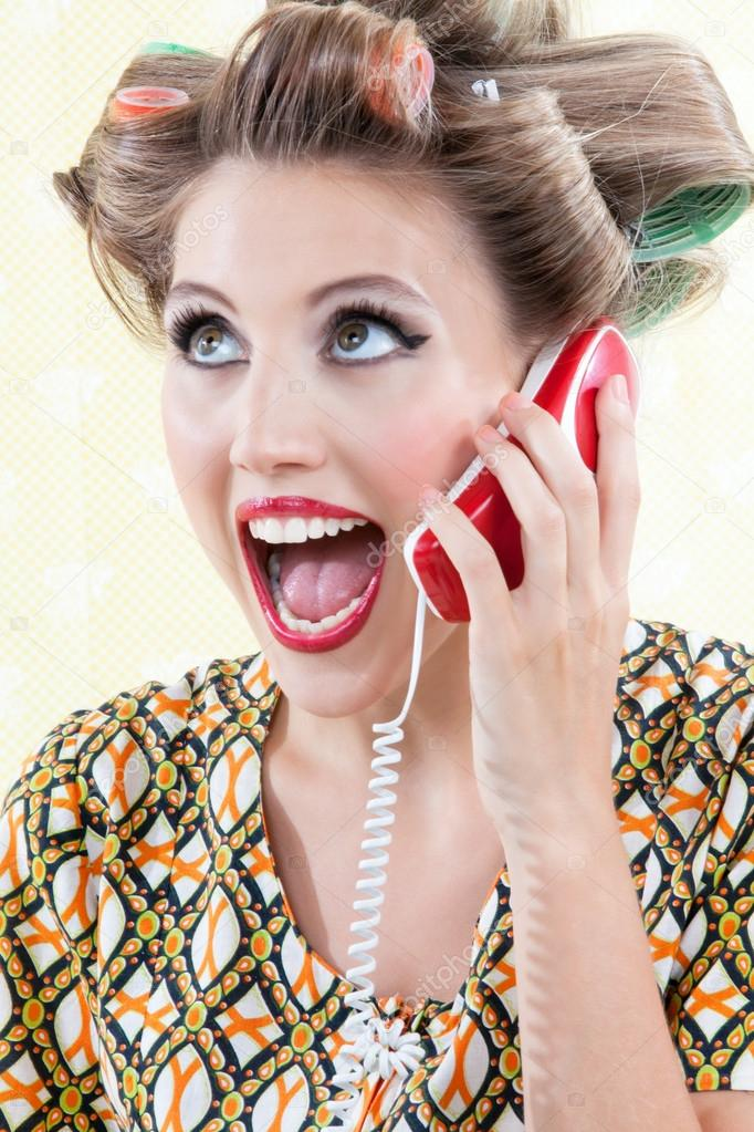 Portrait of funny surprised woman using telephone.  Stock Photo #12679844