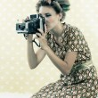 Woman taking Photograph — Stock Photo #12680083