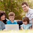 Outdoor Family with Computer — Stock Photo