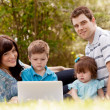 Outdoor Family with Computer - Stockfoto