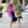 Women Looking Into Shopping Bags — Stock Photo