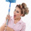 Humourous Woman with Duster — Stock Photo #12748064