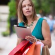 Stock Photo: Shopping Woman holding Digital Tablet
