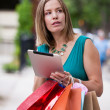 Shopping Woman holding Digital Tablet — Stock Photo
