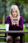 Woman in Park using Cell Phone — Stock Photo