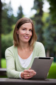 Woman holding Digital Tablet — Stock Photo