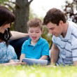 Family in Park with Digital Tablet — Stock Photo