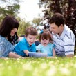 Outdoor Family with Digital Tablet — Stock Photo