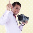 Retro Styled Man Holding Finger in Air — Stock Photo