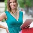Stock Photo: Woman With Shopping Bags And Digital Tablet